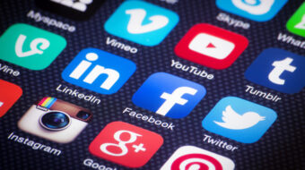 Various social media icons on a mobile device - representing the importance of social media in inbound marketing.